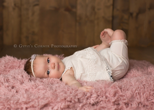 Buffalo Milestone session Photographer|Baby Girl on flokati|Gypsys Corner Photography