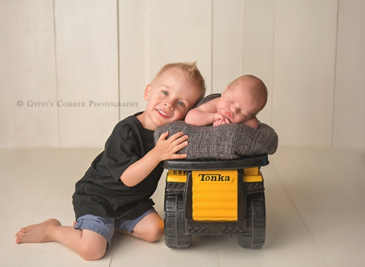 Buffalo Newborn Photographer|Big Brother and Baby boy in a tonka truck|Gypsys Corner Photography